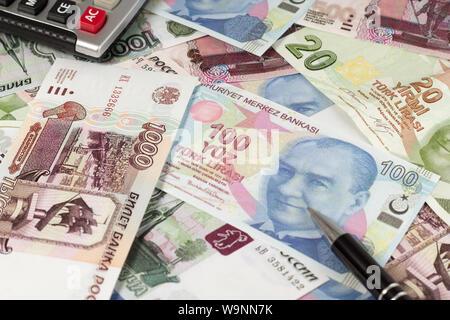 Two european currencies - Russian ruble and Turkish Lira - Stock Photo