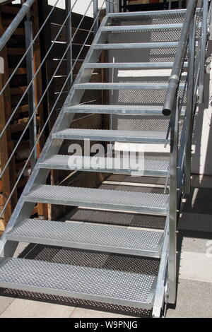 a galvanized steel staircase with railing