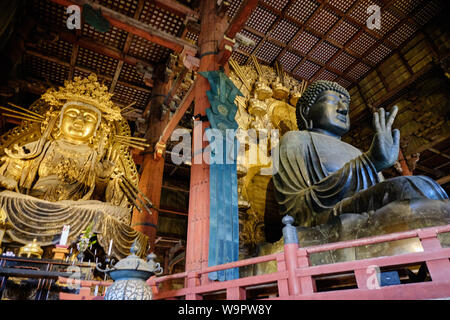 The interior of the ancient daibutsuden at Todaiji, Nara houses the worlds largest statue of Buddha cast in bronze. - Stock Photo