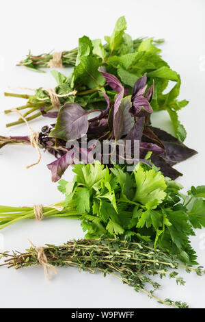 Various fresh herbs on white background. Rosemary, parsley, thyme, mint and basil. - Stock Photo