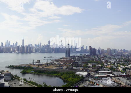Panoramic view over Manhattan from Greenpoint, New York City, USA. - Stock Photo