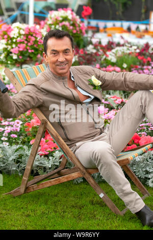 Southport, Merseyside, UK. 15th August 2019.  Strictly Come Dancing judge Bruno Tonioli casts his critical eye over the show winning gardens as he opens the 2019 Southport Flower Show in Merseyside.  The TV favourite welcomed visitors to the seaside event as it celebrates its 90th anniversary this week with a giant garden party.  Credit: MWI/ALAMYLIVENEWS - Stock Photo