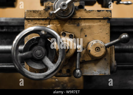 background - detail of an old manual metalworking turning lathe - Stock Photo