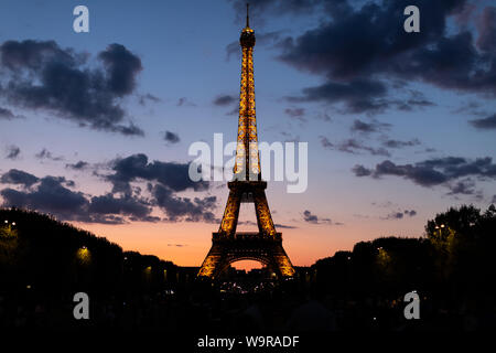 The Eiffel Tower in Paris France is illuminated as it is each night.