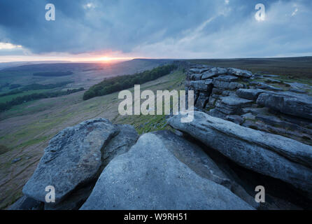 Sunset over Stanage Edge. Peak District National Park. Derbyshire. UK. - Stock Photo