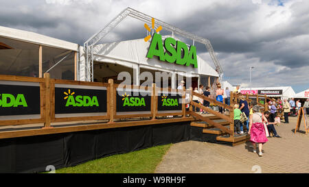 Agricultural show visitors going in to large temporary Asda convenience shop (by trade stands in retail area) - Great Yorkshire Show, Harrogate, UK. - Stock Photo
