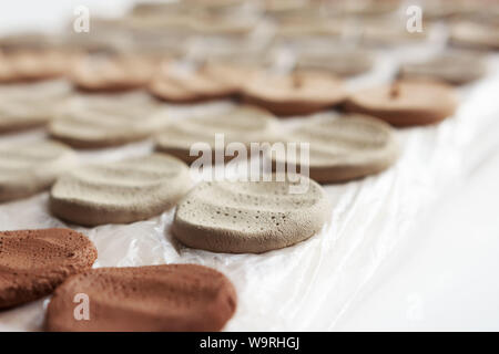 clay samplers dry. Spanish stone masses in the form of round pellets for testing glazes. - Stock Photo