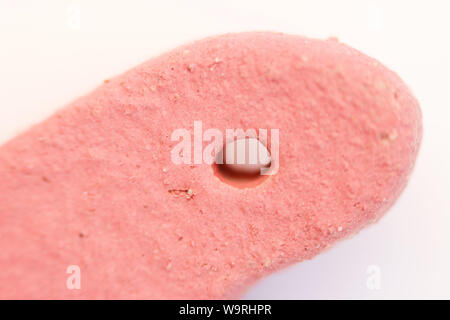 clay heart with red engobe in the drying process. macro photography - Stock Photo