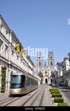 Tram on Rue Jeanne d'Arc with Cathedral Sainte-Croix, Orleans, in the background. France July 2019 - Stock Photo