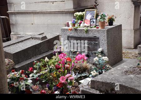 Jim Morrison's grave, Pere-Lachaise cemetery Paris, France August 2019 - Stock Photo