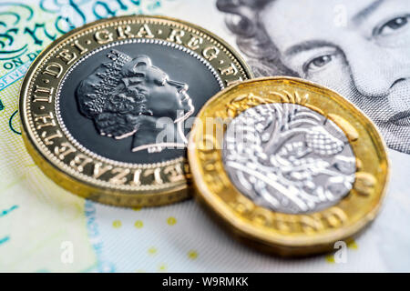 British pound sterling coins and banknote - Stock Photo