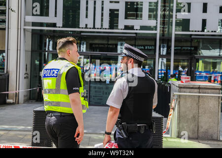 London, UK, 15th August, 2019. Scene in Marsham Street, outside the Home Office in Westminster, as police respond to reports of a stabbing. - Stock Photo