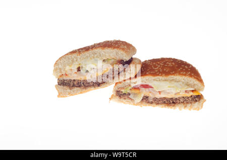 Burger King Impossible Whopper with cheese cut in half showing vegetarian, plant based, meat free patty - Stock Photo