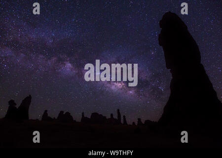 Silhouette of rock formations against the milky way at night, Riyadh, Saudi Arabia - Stock Photo