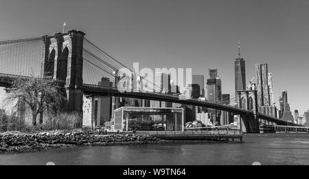 A black and white picture of Lower Manhattan and the Brooklyn Bridge. - Stock Photo