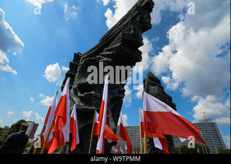 Polish flags stand next to the Monument of Silesia Insurgents during the event held in Katowice.On the occasion of the Polish Army Day, the 99th anniversary of the Battle of Warsaw and the 100th anniversary of the outbreak of the First Silesian Uprising, for the first time official celebrations took place out of the capital, Warsaw. - Stock Photo