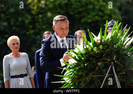 President of Poland, Andrzej Duda, lays  wreath at the Monument of Silesia Insurgents during the event held in Katowice.On the occasion of the Polish Army Day, the 99th anniversary of the Battle of Warsaw and the 100th anniversary of the outbreak of the First Silesian Uprising, for the first time official celebrations took place out of the capital, Warsaw. - Stock Photo