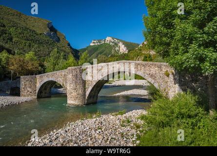 Roman bridge over Rio Esca in Burgui (Burgi), Valle del Roncal, Pyrenees, Navarra, Spain - Stock Photo