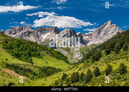 Limestone peaks of Aragonese Pyrenees, seen from Carretera de Aguas Tuertas, GR11, over Valle de Echo in Natural Park of Western Valleys, Aragon Spain - Stock Photo