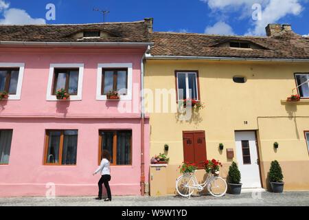The pretty, coloured houses on Str Cetatii, in Sibiu's old town, in Transylvania, Romania - Stock Photo