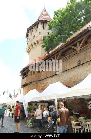 Gastronomy food market on historic Str Cetatii, in the old town of Sibiu, in Transylvania, Romania - Stock Photo