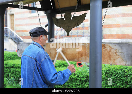 Signal that the service is starting at Holy Trinity Cathedral, seat of the Romanian Orthodox Archbishop & Metropolitan of Transylvania, Sibiu, Romania - Stock Photo