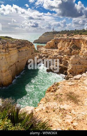 Farol de Alfanzina, a lighthouse near Carvoeiro at the southern coast of the Algarve, Portugal. - Stock Photo