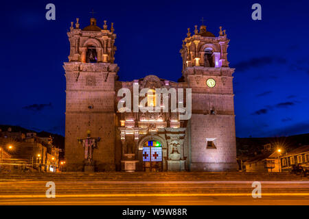 Evening view of Cathedral Basilica of Saint Charles Borromeo in Puno, Peru, South America - Stock Photo