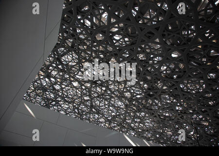 The roof at the Louvre Abu Dhabi is made up of 7850 stars. --- The Louvre Abu Dhabi is an art and civilization museum, located in Abu Dhabi, UAE. - Stock Photo