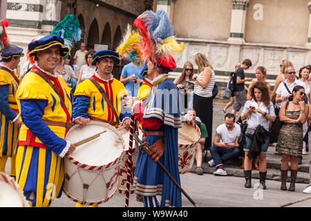 Traditional costumes at the Calcio Storico parade in Florence, Italy. Also known as Calcio Fiorentino the game is thought to be an early form of moder - Stock Photo