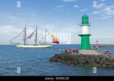 Columbian bark Gloria leaving Hanse-Sail with sailors standing on the masts, Warnemünde, Rostock, Mecklenburg-West Pomerania, Germany - Stock Photo