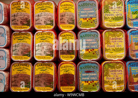 Stacks of tins of various types of sardines on display in Conserverie la belle-iloise in Dieppe, France. - Stock Photo