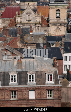 Closeup view of central Dieppe rooftops with typical French classical architecture and Saint-Rémy church in the background. - Stock Photo