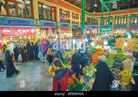 TEHRAN, IRAN - OCTOBER 25, 2017: Crowded fruits and vegetables section of Tajrish Bazaar - one of the oldest market areas of the city with large trade - Stock Photo