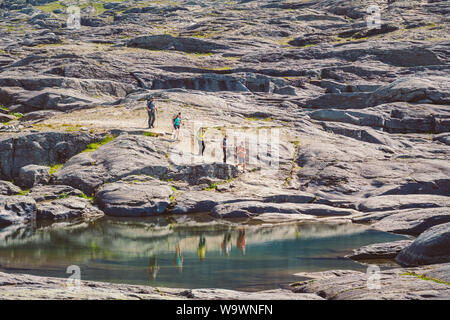 July 26, 2019. Norway tourist route on the trolltunga. People tourists go hiking in the mountains of Norway in fine sunny weather to thetrolltunga Stock Photo