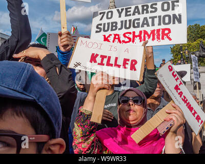 London, UK. 15th August 2019. People including many Kashmiris protest and hold up placards in Trafalgar Square on Indian Independence Day callling Modi a killer and for India to leave Kashmir which has been subjugated for 70 years. Peter Marshall/Alamy Live News - Stock Photo