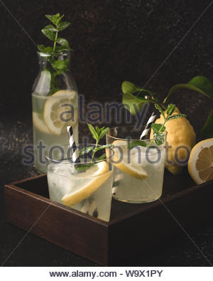 juice of bottle and two drinking glass close-up photography - Stock Photo