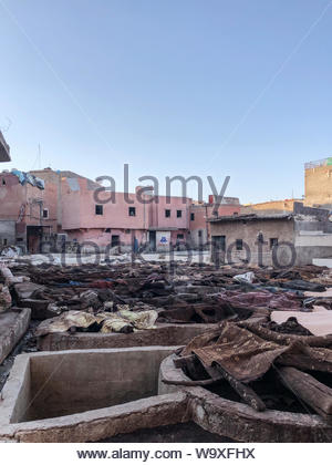 Textiles on concrete field near buildings - Stock Photo