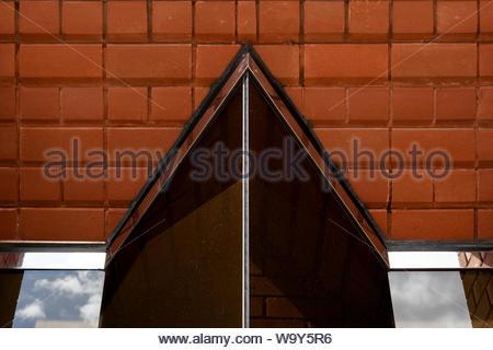 Close up image of a an unusually shaped modern window in Newbury, Berkshire, England, UK - Stock Photo