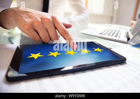 Man Giving Positive Feedback On Tablet With Five Yellow Star On The Screen - Stock Photo