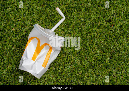 McDonald's Empty Cola Cup with Paper Straw, McDonald's is the world's largest chain of hamburger fast food restaurants. - Stock Photo