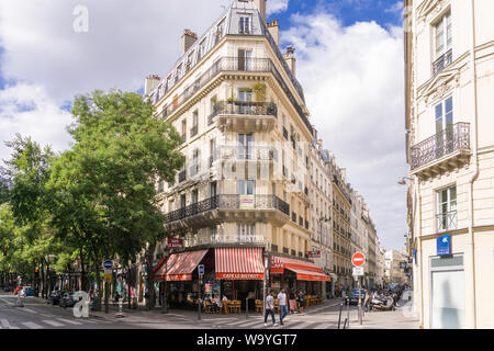 Paris street scene on Boulevard Magenta, in front of the cafe Le Bistrot, in the 10th arrondissement. France, Europe. - Stock Photo
