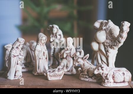 A closeup of decorative Christian figures carved from wood - Stock Photo