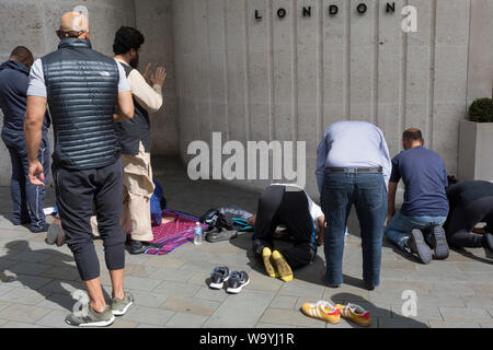 As Indians celebrate their Independence Day, Kashmiris and Pakistanis pray near India House, the Indian High Commission in London's Aldwych, during a protest about Indian PM Narendra Modi's recent decision to strip Indian-administered Kashmir of its special status, London, on 15th August 2019, in London, England. - Stock Photo
