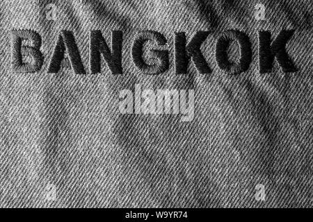Background blue jeans labeled Bangkok embroidery on jeans. - Stock Photo