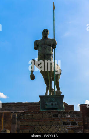 Pompeii, Italy statue of Centaur. Modern statue by Polish sculptor Igor Mitoraj on the forum of the archaeological site of the ancient Roman city. - Stock Photo