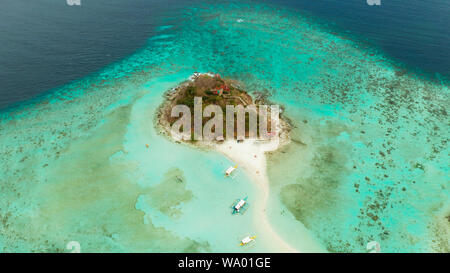 aerial seascape tropical island and sand beach, turquoise water and coral reef. malacory island, Philippines, Palawan. tourist boats on coast tropical island. - Stock Photo