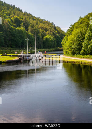 Crinan, Scotland, UK  - June 3, 2011: A pair of small sail boats pass through Dunardry Lock No. 10 on the Crinan Canal in Argyll in the West Highlands - Stock Photo
