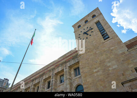 clock tower of the palazzo delle poste centrale (main post office) with marble covering designed by the architect Angelo Mazzoni in the city centre of - Stock Photo