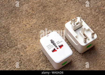 Close up of universal electric socket plug adapters used for travel. Used to connect to different electrical outlets worldwide. Electric adapter isola - Stock Photo